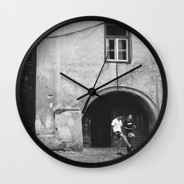 Children playing ball on the street  Wall Clock