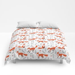 Red foxes and berries in the winter forest Comforters