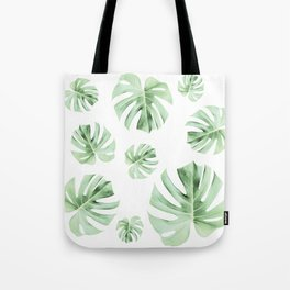 Tropical green leaves on white Tote Bag