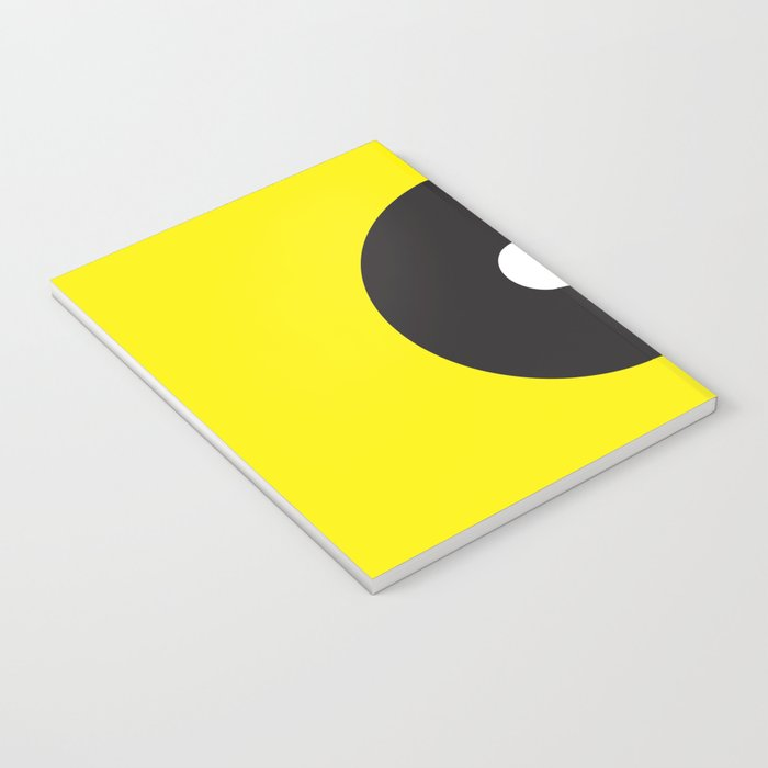 White dot on black on yellow Notebook