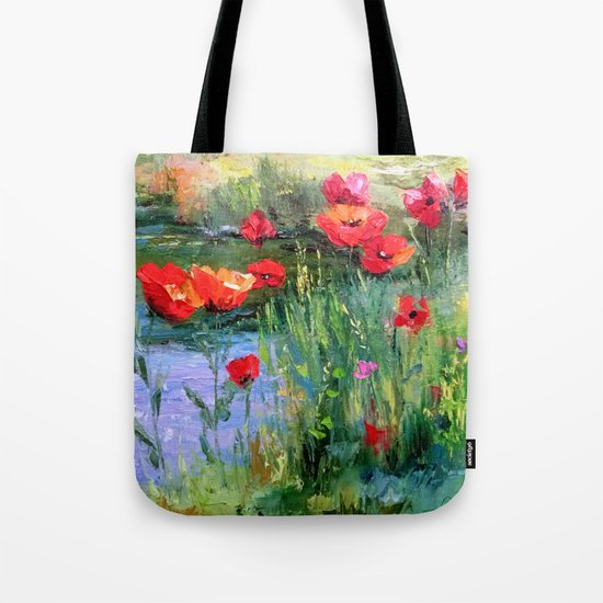 Poppies in a field near a pond Tote Bag