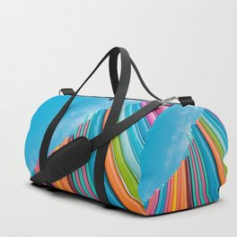 Colorful Rainbow Pipes Against Blue Sky Duffle Bag
