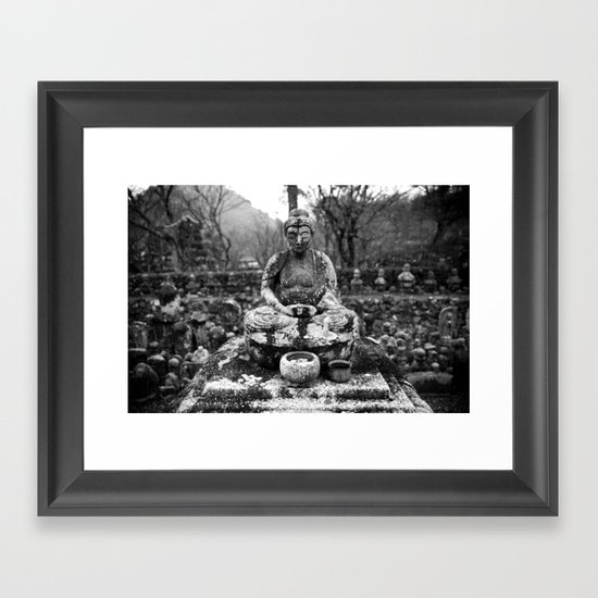 Buddha in the snow Framed Art Print