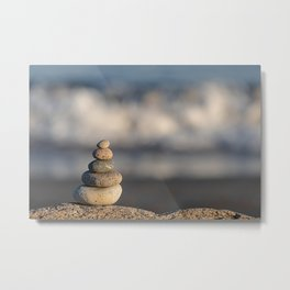 Pebbles stacked on the beach Metal Print