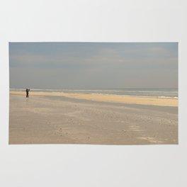 the photographer on the beach Rug