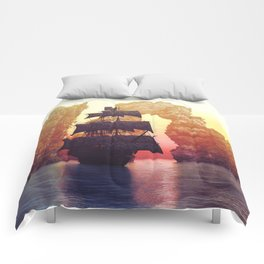 A pirate ship off an island at a sunset Comforters