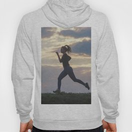 Running woman morning workout. Female Runner. Jogging during sunrise. Workout in a Park. Sporty Hoody