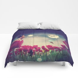 Dream fairy in fantasy land with bright red tulips at night time Comforters