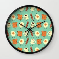 mega man Wall Clocks featuring Let's All Go And Have Breakfast by Teo Zirinis
