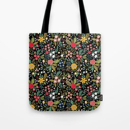 Amazing floral pattern with bright colorful flowers, plants, branches and berries on a black backgro Tote Bag
