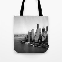 manhattan Tote Bags featuring Manhattan  by Pretty In Palms Designs