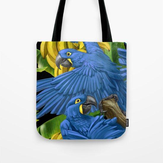Hyacinth Macaws and bananas Stravaganza (black background). Tote Bag