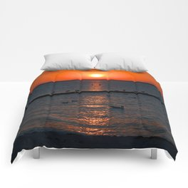 Holy sunset on the Baltic Sea Comforters