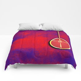 Gold cross in red egg hanging against a rich red and purple Comforters