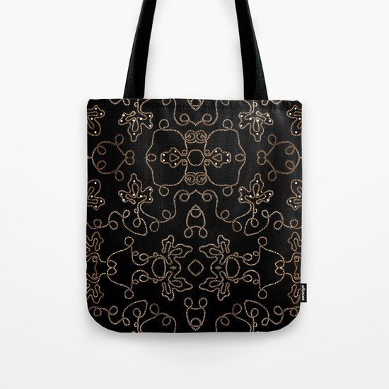 Elegant gold embellishments on black Tote Bag