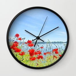 Red poppies in the lakeshore Wall Clock