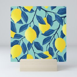 Vintage yellow lemon on the branches with leaves and blue sky hand drawn illustration pattern Mini Art Print