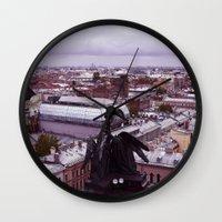 cityscape Wall Clocks featuring cityscape by Gayana Manukova