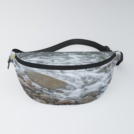 Wave washing over pebbles Fanny Pack