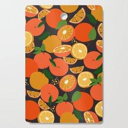 Oranges on black Cutting Board