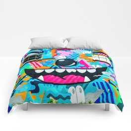 Face on a wall Comforters