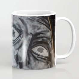 Mural graffiti of two faces that merge with a crown of thorns Coffee Mug