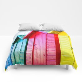 Colourful beach huts on the seaside Comforters