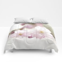 Delicate and fliligrane flowering of the almond tree Comforters