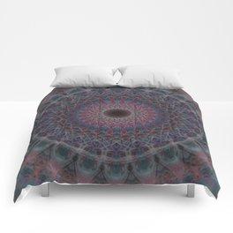 Mandala in blue and red tones Comforters