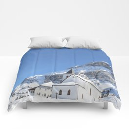 Church in the snow Comforters