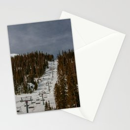 Empty chairlift at Taos Ski Valley in Taos, New Mexico on dark, gloomy day in autumn forest Stationery Cards