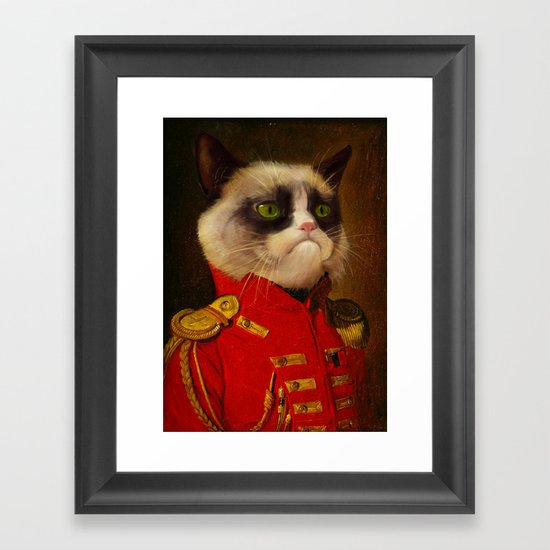The cat is Grumpy Framed Art Print