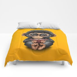 Cute Baby Chimp Reading a Book on Yellow Comforters