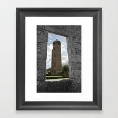 Tower Through The Rain  Framed Art Print
