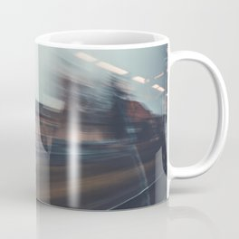 Long exposure photo of a train passing through the city Coffee Mug