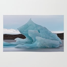 Big blue iceberg in front of a glacier Rug