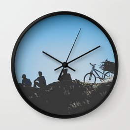 Teenagers sitting on a Hill Wall Clock