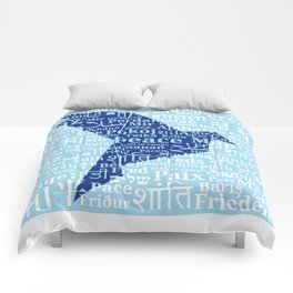 """Dove-origami on the background of the word """"Peace"""" in different languages of the World Comforters"""