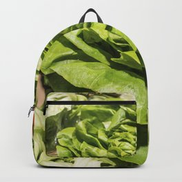 Fresh green lettuce in a grocery store Backpack