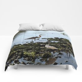 Herons on the river bank Comforters