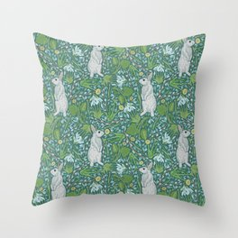 Grey hares with coltsfoots and snowdrops on green background Throw Pillow