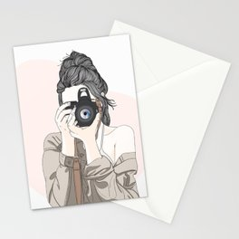Female photographer with a professional camera. Stationery Cards