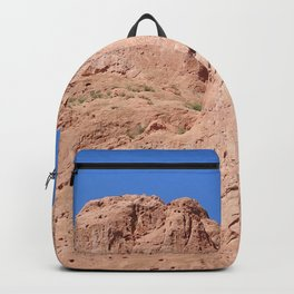 Red Stone Formation against a Blue Sky Backpack