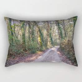 Country road surrounded by a forest in a natural park during autumn Rectangular Pillow