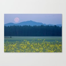 Full Moon setting over mountains and rapeseed Canvas Print