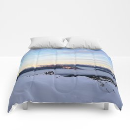Morning light sweeping mountain peaks above sea of clouds Comforters