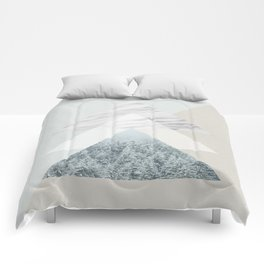 Snow into the forest Comforters
