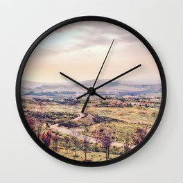 countryside view with sunset sky and green field with mountain view Wall Clock