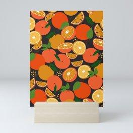 Oranges on black Mini Art Print