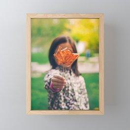 Girl holding a dry leaf Framed Mini Art Print